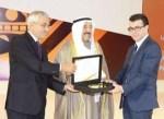 Emir giving the prize to Bizri