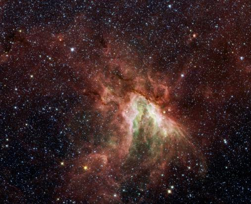 NASA's Spitzer Space Telescope has captured a new, infrared view of the choppy star-making cloud called M17, also known as Omega Nebula or the Swan nebula.